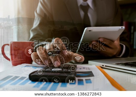 Business finance and business people use smartphones with laptops at the office. #1386272843