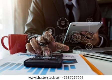 Business finance and business people use smartphones with laptops at the office. #1387217003