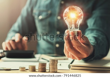 business finance and saving power. new idea solar energy with accounting concept