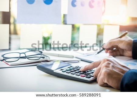 Business finance man calculating budget numbers, Invoices and financial adviser working.