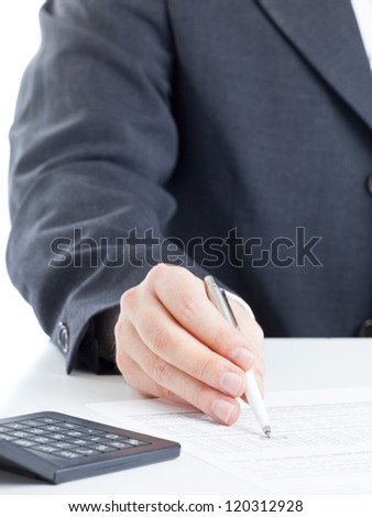 Business finance man calculating budget numbers with calculator - stock photo