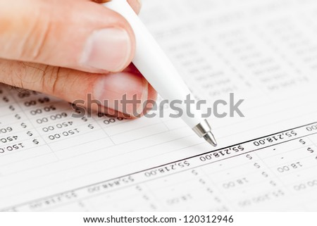 Business finance man checking budget numbers on document printouts