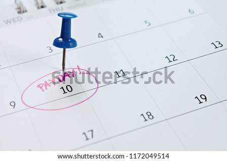 Business, finance, savings money, wages, payroll or accounting concept : Calendar with Blue thumbtack in word payday for remind