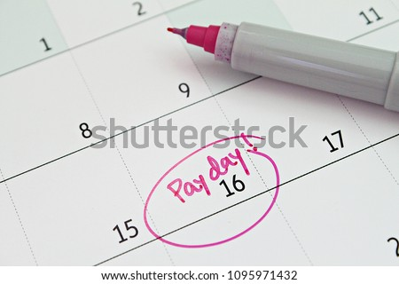 Business, finance, savings money, wages, payroll or accounting concept : Calendar with pink marker circle in word payday for remind
