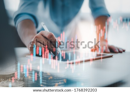 business finance technology and investment concept. Stock Market Investments Funds and Digital Assets. businessman analysing forex trading graph financial data. Business finance background. Stockfoto ©
