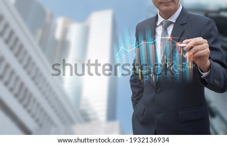 Business finance technology, Real estate development, economic marketing report concept. Smart businessman working with electronic pen pen pointing digital data, financial graph on virtual screen