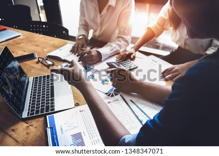 Business financial, accountant discussing with partner are meeting to audit finance planning sales to meet targets set in next year. stock market concept.