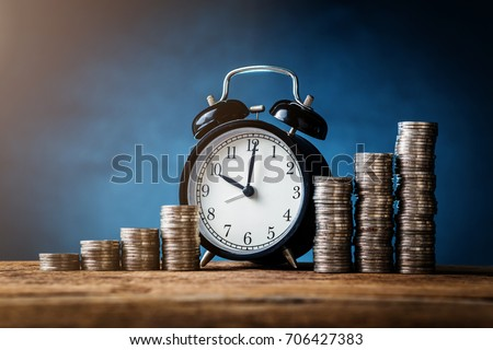 business financial ideas concept with coins stack and alarmclock isolate background with free copyspace for your creativity ideas text #706427383