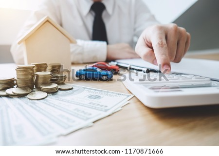 Business Financing Accounting Banking Concept, businessman doing finances and calculate about cost to real estate investment, Concept mortgage loan approval.