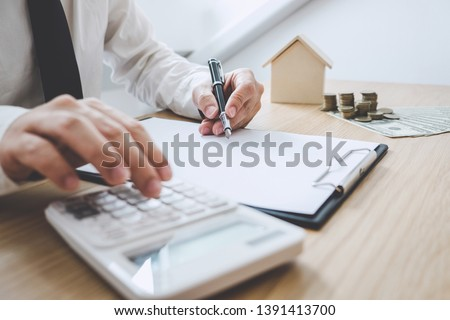 Business Financing Accounting Banking Concept, businessman doing finances and calculate about cost to real estate investment, Concept mortgage loan approval. #1391413700