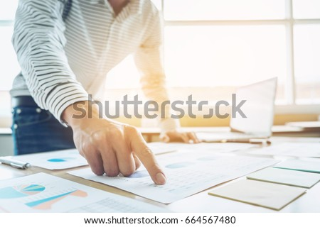 Business Financing Accounting Banking Concept, businessman doing finances and calculate about cost to real estate investment and in other, tax system.