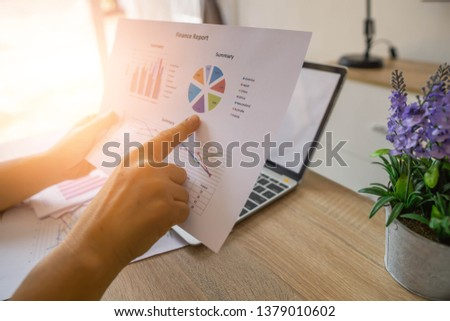 Business Financing Accounting Banking Concept, businesswoman doing finances and analyze about cost to real estate investment and in other, tax system.