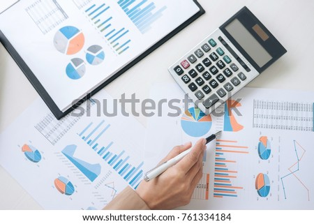 Business Financing Accounting Banking Concept, businesswoman working new plan financial graph data on laptop and doing finances, calculate investment and business strategy.