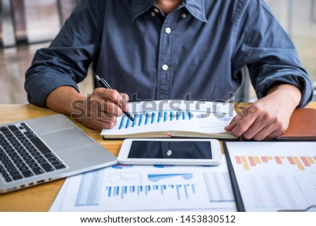 Business Financing Accounting Banking Concept, Professional Senior businessman doing finances and calculate income on digital tablet about cost to real estate investment and in other, tax system.