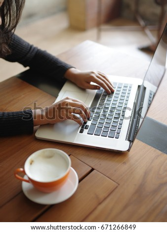 business girl working with laptop in coffee shop cafe