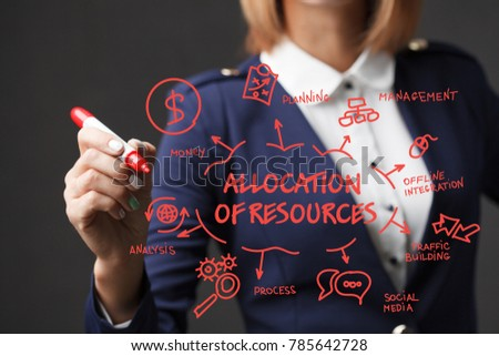Business girl writes a red marker development strategy. The concept of marketing.Allocation of resources