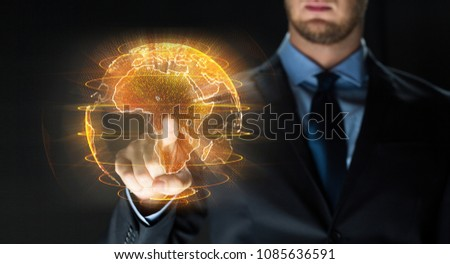 business, globalization and future technology concept - close up of businessman with earth hologram over black #1085636591