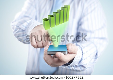 Business graph coming out from touch screen mobile phone. Concept for using table for business