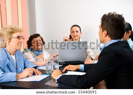 Business group of people young and seniors having a meeting in an office