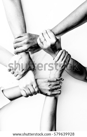 Shutterstock Business group United Hands together with Spirit in Solarization effect stype- teamwork concepts.