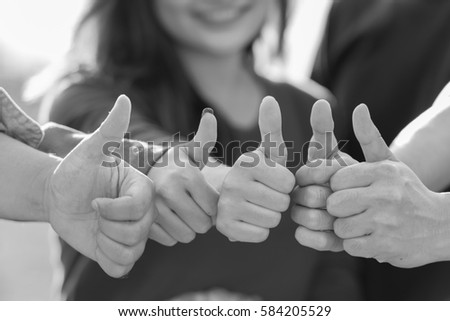 Business group United hands with thumbs up  together expressing positivity - teamwork concepts. #584205529