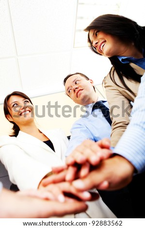 Business group with hands together in the middle - teamwork concepts