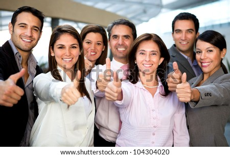 Business group with thumbs up at the office