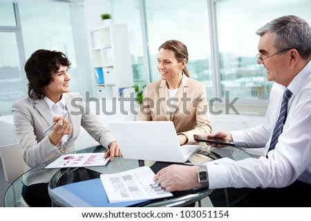 Business group working together in office