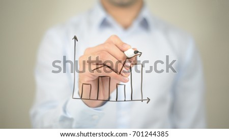 Business Growth Graph, man writing on transparent screen #701244385
