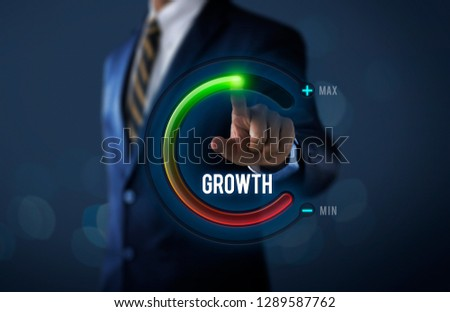 Business growth or career growth concept. Businessman is pulling up circle progress bar with the word GROWTH on dark tone background. #1289587762