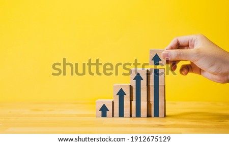Business growth or step for success concepts with arrow graph, on wood.financial,profit of investment. Photo stock ©