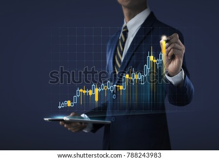 Business growth, progress or success concept. Businessman is drawing a growing virtual hologram stock on dark tone background.