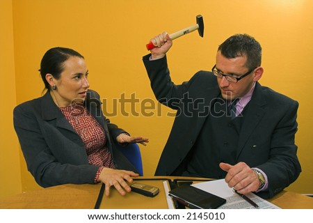 Business hammer attack - stock photo