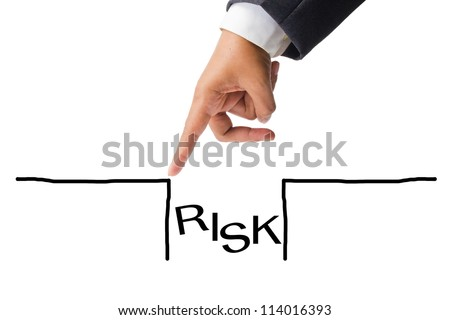 Business hand as finger jumping over the risk hole