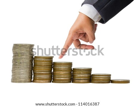 Business hand as finger running on heap of coins