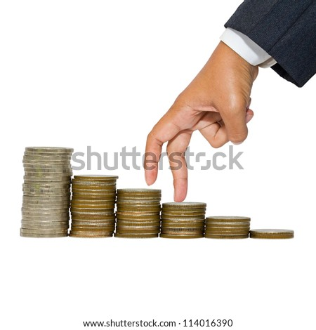 Business hand as finger stepping on heap of coins