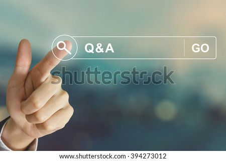 business hand clicking Q&A or Question and Answer button on search toolbar with vintage style effect