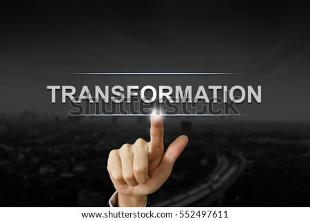 business hand clicking transformation button on black blurred background #552497611