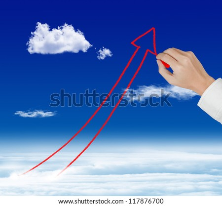 business hand drawing rising arrow graph over sky