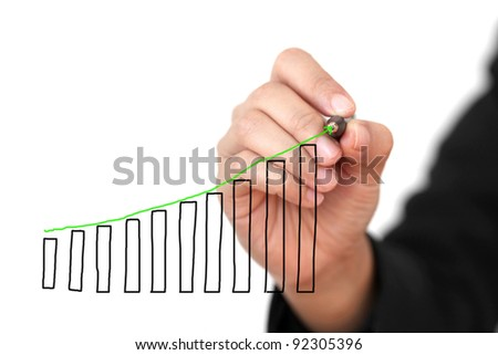 Business Hand Drawing Sales Uptrend Graph Isolated (Selective focus on pen and graph)