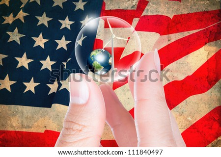 Business hand hold earth and turbine  in bubble on vintage flag USA  (Elements of this image furnished by NASA)