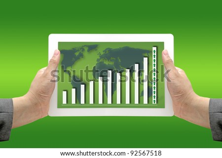 Business Hand Hold Technology  Touch Screen Pad Interface with up Trend Revenue Graph