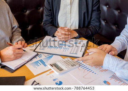 Business hand pointing at business document during discussion at meeting. Business concept. #788764453