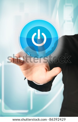 business hand press power button on touch screen