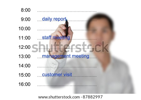business hand writing appointment schedule on white board