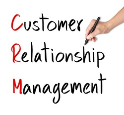 business hand writing customer relationship management ( crm ) concept