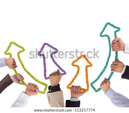 Business hands holding colorful arrows pointing upwards