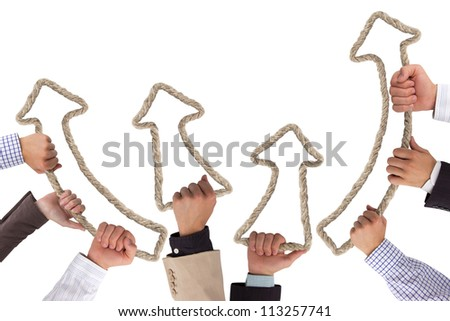Business hands holding rope forming arrows pointing upwards