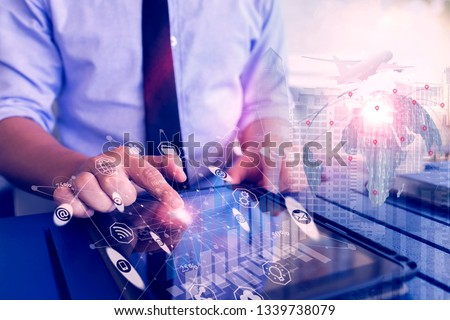 Business hands using tablet on abstract city background.Technology and network concept. Double exposure #1339738079