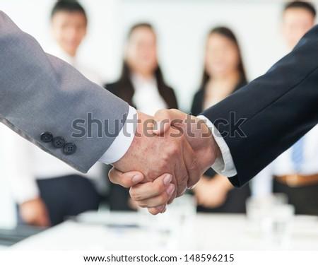 Business Handshake - Shutterstock ID 148596215